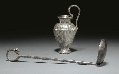 AN EAST GREEK OINOCHOE AND LAD
