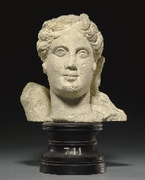 A CYPRIOT LIMESTONE HEAD OF AR