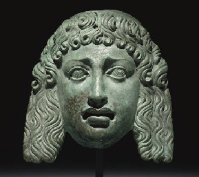 A ROMAN BRONZE THEATER MASK