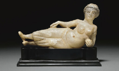 A PARTHIAN ALABASTER RECLINING