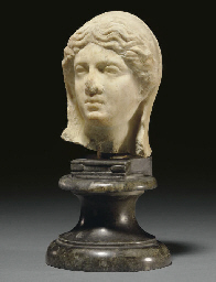A ROMAN MARBLE FEMALE HEAD