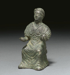 A BYZANTINE BRONZE SEATED FIGU