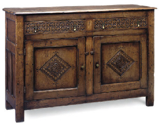 AN OAK SIDE CABINET