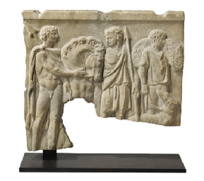 A RELIEF CARVED STONE SARCOPHA