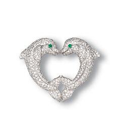 A DIAMOND AND EMERALD DOLPHIN