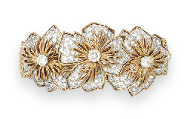 A DIAMOND AND GOLD BRACELET, B