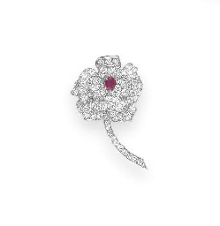 A DIAMOND AND RUBY BROOCH, BY
