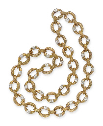 A GOLD AND DIAMOND LONGCHAIN N