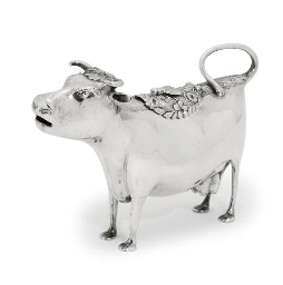A GEORGE III SILVER COW-CREAME