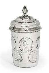 A GERMAN SILVER COIN BEAKER AN