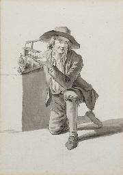 Jeune garçon agenouillé tenant
