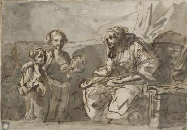 Une femme assise avec deux enf