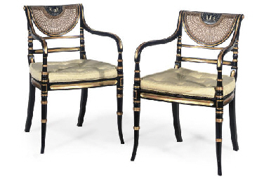 A PAIR OF EBONISED AND GILT AR