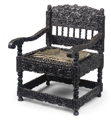 A CARVED EBONY ARMCHAIR