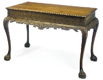 A CARVED MAHOGANY CENTRE TABLE