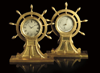 AN EDWARDIAN GILT-BRASS TIMEPI