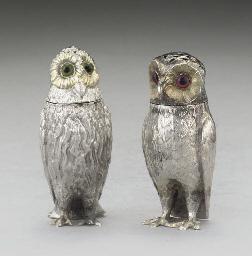 TWO VICTORIAN SILVER OWL CONDI