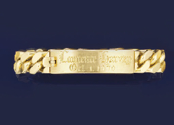 AN 18CT. GOLD IDENTITY BRACELE