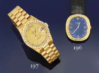 AN 18CT. GOLD AUTOMATIC CALEND