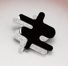 A DIAMOND AND ONYX BROOCH, BY