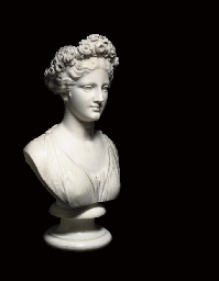 A CARVED MARBLE BUST OF FLORA