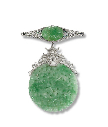 AN ART DECO JADE AND DIAMOND P