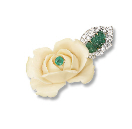 AN IVORY, EMERALD AND DIAMOND