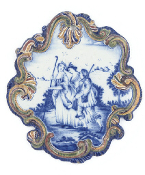 A DUTCH DELFT POLYCHROME PLAQU