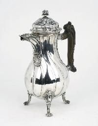 A Belgian silver chocolat pot