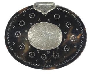 A silver-mounted tortoiseshell