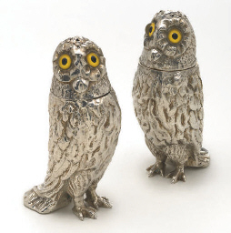 A pair of silver owl pepperett