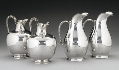A PAIR OF GREEK METALWARE JUGS