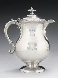 A SILVER COVERED JUG