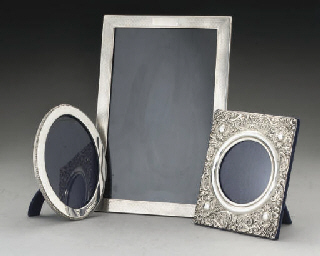 THREE SILVER MOUNTED PHOTOGRAP