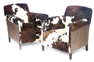 A PAIR OF COW HIDE UPHOLSTERED