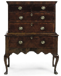 A GEORGE I WALNUT CHEST ON STA