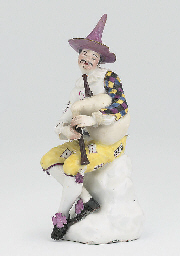 A MEISSEN FIGURE OF HARLEQUIN
