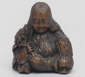A japanese wood netsuke of a S