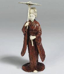 A Japanese Okimono, signed Ikk