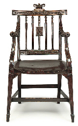 A GEORGE III OAK ARMCHAIR