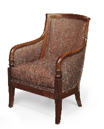 A LATE EMPIRE MAHOGANY BERGÈRE