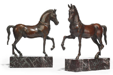 A PAIR OF PATINATED BRONZE CAS