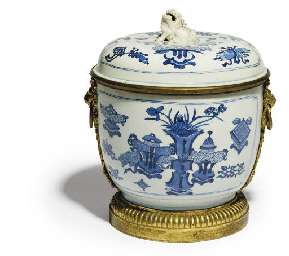 AN ORMOLU-MOUNTED BLUE AND WHI