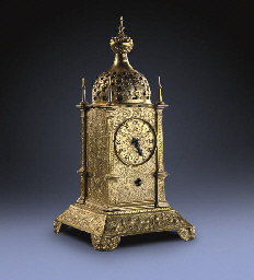 A German small engraved gilt-brass and gilt-copper striking tischuhr