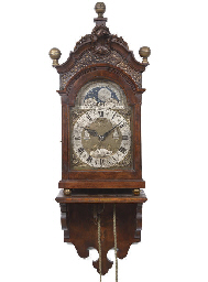 A DUTCH WALNUT STRIKING BRACKET CLOCK WITH MOONPHASE AND CALENDAR