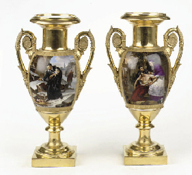 A pair of Paris heavily gilt t