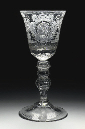 A Dutch-engraved armorial faceted goblet