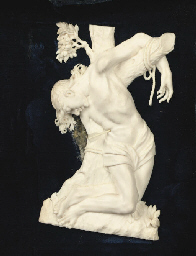 A CARVED IVORY RELIEF OF SAINT