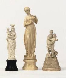 A GERMAN CARVED IVORY FIGURE O
