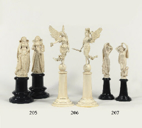 A PAIR OF CARVED IVORY FIGURES